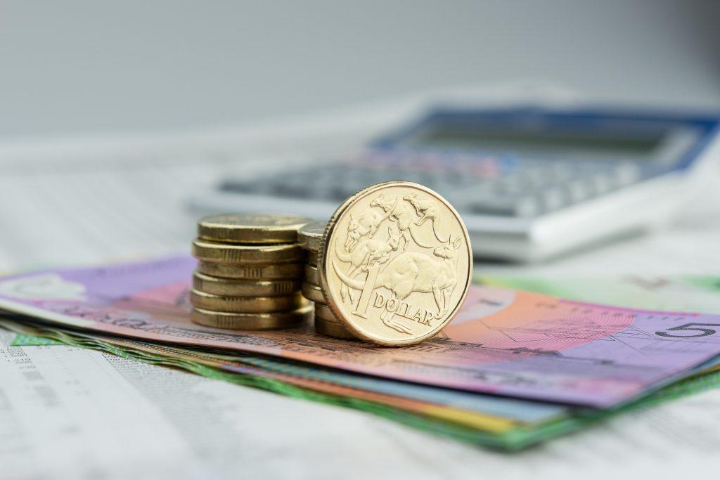Calculator, coins, and bills