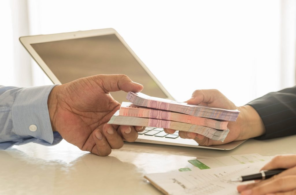 Businessman receiving his loan